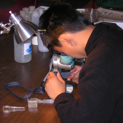 student on microscope