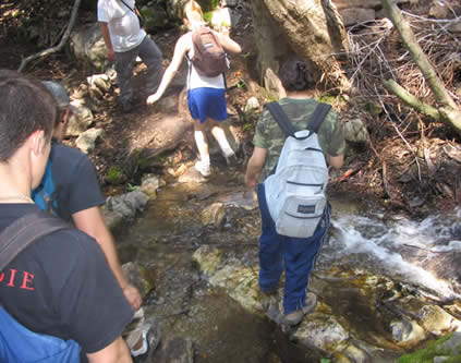 group crossing stream