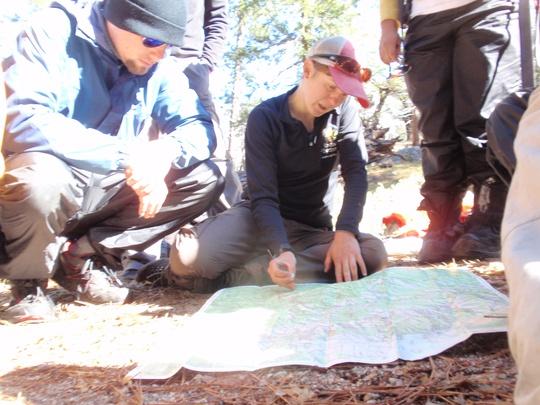 Mitchel studies the map