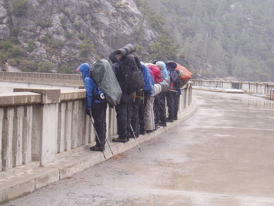 Standing on the bridge in the rain
